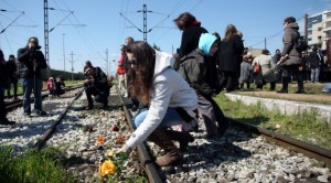 Always Remember: Participants in a ceremony marking the 70th anniversary of the deportation of Jews from Greece toss flowers on the railroad tracks in the city of Thessaloniki.