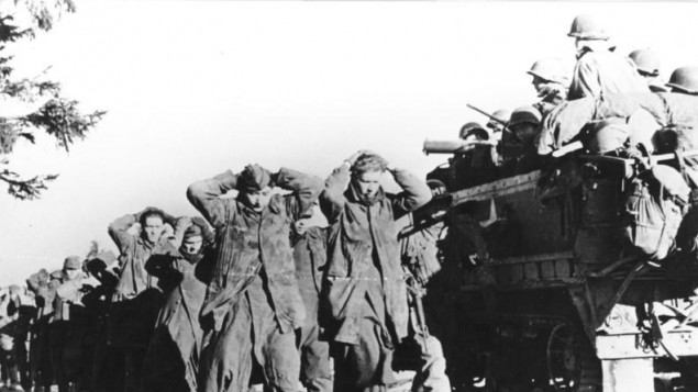 Nazi troops march to the rear as American forces advance in Belgium, December 1944. (photo credit: US Signal Corps/public domain)  Read more: Nazis formed secret army to overthrow Allies after WWII