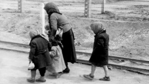 An old Jewish woman with children at Auschwitz-Birkenau, May 1, 1944. (Wikipedia/Hannolans/CC BY-SA 3.0 DE)