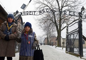 (FILES) This photo taken on January 27, 2014 shows a former concentration camp prisoner attending (R) a ceremony at the memorial site of the former Nazi concentration camp Auschwitz-Birkenau in Oswiecim, Poland, on Holocaust Day. Mostly in their nineties now, some are still well enough to attend on January 27, 2015 ceremonies marking 70 years since the Soviet Red Army liberated Auschwitz, the largest German death camp, on January 27, 1945 in what is now southern Poland.  AFP PHOTO/JANEK SKARZYNSKI