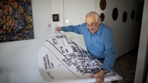 In this Oct. 31, 2010 file photo, Holocaust survivor Samuel Willenberg displays a map of Treblinka extermination camp during an interview with the Associated Press in Tel Aviv, Israel. (AP Photo/Oded Balilty, File)